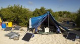 In 2013 we set up camp at Punta Pitt in order to sample intensively at this remote location and run a project to monitor feral cats in the area. This is the office tent with solar panels to charge the equipment.